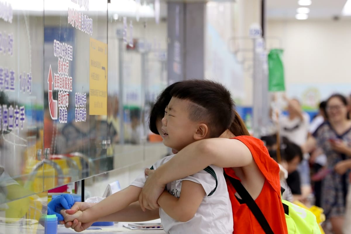 A boy has his blood sample collected at a children's hospital in Shanghai